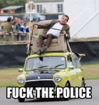 2011 car chair clothed clothing derp_eyes driving english_text footwear fuck_the_police fully_clothed group human human_only humor image_macro legwear lol_comments male mammal mini_(car) mr._bean not_furry outside pants police reaction_image real recliner rowan_atkinson shoes socks solo_focus text tongue tongue_out unknown_artist vehicle